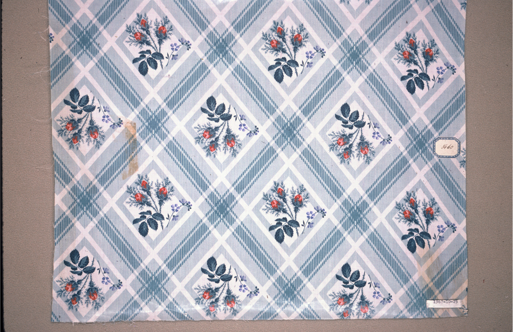 Ground, molette printed in blue, of vertical stripes forming large diamond pattern; centering each diamond is a spray of blue forget-me-nots, three red rosebuds and blue leaves (a darker hue of the ground color).