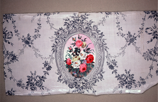 Grey ground printed in darker grey with pattern of floral garlands surrounding elaborate oval frame bedecked with roses; frame encloses floral bouquet, mostly roses, printed in pink, yellow, blue, red, grey, green and white.