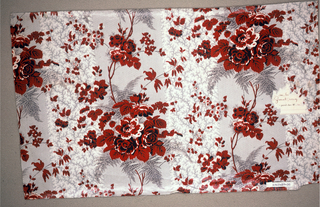 Ground printed in grey by molette; minute dots form pattern of fern leaves, picotage of stripes. Over-printed with delicate rose cluster and foliage pattern in red, white and black.
