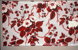 Ground printed in grey, by molette, in minute all-over disapered pattern; clusters of white moss roses, red raspberries and foliage connected by slender meandering vine, are printed over the molette ground.