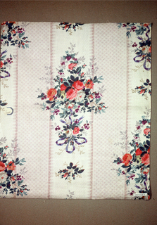 """a) Ground printed by """"molette"""" in broad fancy stripes in grey, one stripe composed of rosettes, the other dotted, with fancy edge. Long cluster of roses, violets and ribbons printed in dotted stripe in red, grey, shades of green and violet, probably by block. B) Same design on green printed pround. Glazed."""