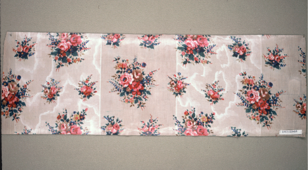 Ground decorated in alternate areas by molette, with horizontal minute bars in deep cream color, and moire effect, alternating with wide section with pin stripe ground in same shade. Small naturalistic rose cluster printed over-ground, probably by block - glazed.