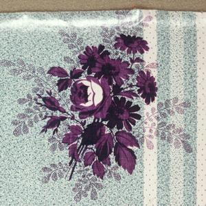 """Two pieces with same ground, different floral pattern. A) Ground green in striped effect, broad band, narrower white and pale green, probably by """"molette."""" Flower clusters in violet printed over ground. B) Same ground, smaller flower clusters in violet. Glazed."""