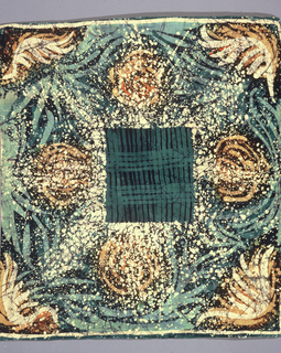 Square scarf in a pattern of green cross-bars forming a square in the center. Corners and borders in shades of orange, brown and green suggest flower heads. Hand hemmed.