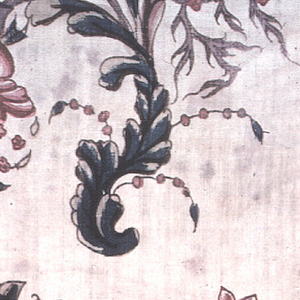 Parts of floral bouquets within guard stripes of red.