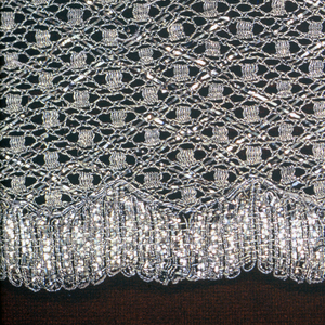 Wide border, metallic gold lace in all over small scale repeated diamond shape.