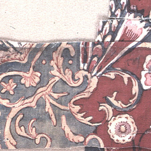 Three fragments of the same fabric showing parts of a cartouche on a red background.