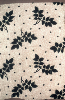 "Cotton, with cream color background, roller printed in small all-over pattern of vine and dotted ground in brown. Over-printed, probably by blocks in detached pattern of leaf sprays in strong green. The green is chemical or ""direct"" green. Glazed."
