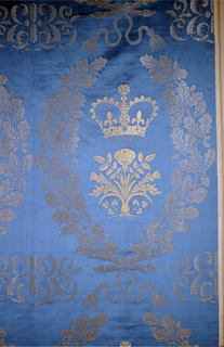 Panel of damask with large scale design of oak leaves, rose and thistle, and crown; gold Lurex pattern on blue satin ground. Made for the coronation of Elizabeth II on June 2, 1953.
