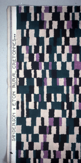 Length patterned by offset rows of rectangles and squares in black, lavender, tan, and green .