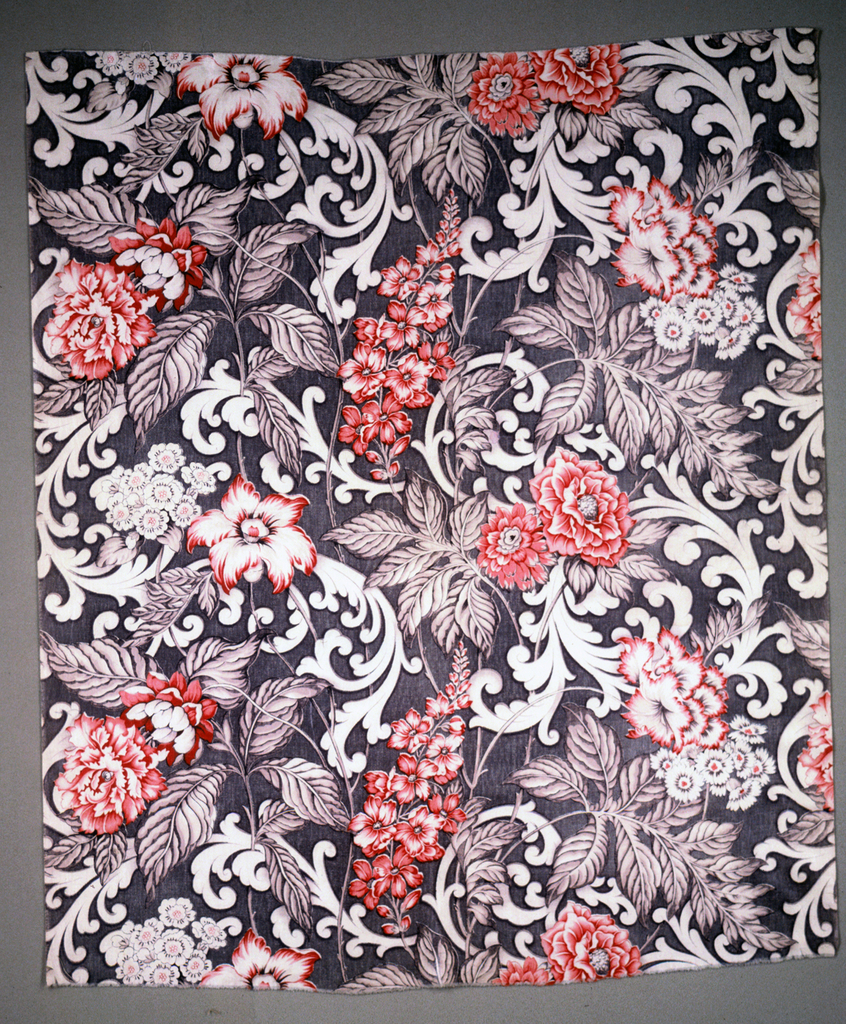 Swirling scrolls and flowers in red and black.