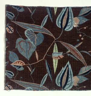 Leaves in blue and yellow on brown background.