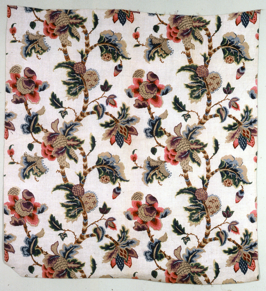 Polychrome block print on coarse natural linen. Two parallel serpentine branches with elaborate and fantastic blossoms in red, pink, purple, blue with large curling fantastic leaves. After the manner of an 18th century painted cotton. Condition: soiled.
