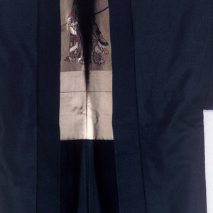 Short black silk coat with two small mon (family crest) on the front and in the middle of the back. Tan silk lining is brocaded with clouds, bridges and a Samurai wearing a helmet and robe with cranes carrying a sword and fan.