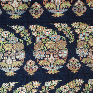 Pattern of horizontal rows of floral botehs in multicolor on blue ground