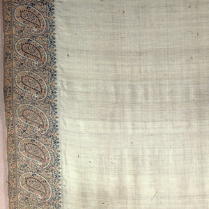 Oblong shawl of ivory silk twill with deep end and side borders of machine woven paisley design. In pale shades of rose, ecru, and soft green.
