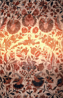 Center of painted cotton; lined with dark green glazed linen, and with wide border of green silk.  Center made of two breadths of cotton, one of 15 inches, one of 19 1/2 inches, seamed;  A repeat pattern, balanced, symmetrical; flower sprays and flowering vines, in formal enframents for paired confronted birds as peacocks with spread wings, squirrels, butterflies, flowers, fruit, and othe rbirds, and touches of plum color.  Much inner detail in flowers.  Birds about 3 1/2 inches, flower spray 5 1/2 inches.   Colors: Two reds, blue, green, yellow, brown, plum color; black for stems and details. The additions of the lining, border of silk, and quilting were made in Europe.