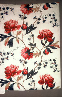 Short length of cream-colored cotton printed with a pattern of brilliant red flowers and peonies on undulating stems.