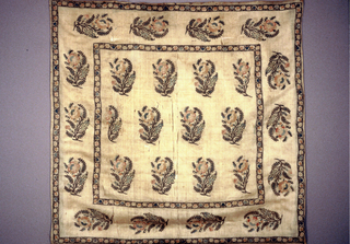 Square with twelve floral sprays in center field and fourteen in outer border. Soft colors on pale yellow silk.