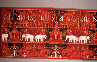 Temple hanging depicting scenes from the life of Buddha. Long horizontal panel with a repeat of various figurative motifs. The panel can be divided into three horizontal bands: top, an elaborate temple protecting a seated figure or image; middle, an elaborate temple with high spire piercing top band protecting a seated figure or image--this temple is guarded by a white elephant on each side plus small human figures and birds; bottom, two leopards facing a shrub growing from a mound alternating with a flowering tree attracting birds. Colors: deep red, red-black, yellow, green, ivory.