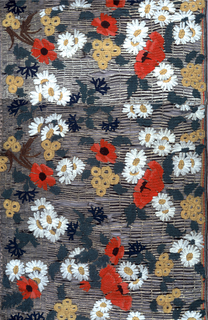 Variety of floral clusters including poppies, daisies and thistles in red, blue, yellow, ivory, and blue-green silk embroidered on a silver fabric with an open grid of slits.