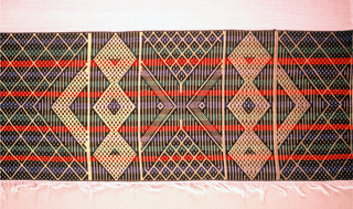 Two panels of sheer white cotton seamed together with a 6 3/4 inch border at both end. Bands and borders are a geometric pattern of triangles, diamonds and chevrons in blue, green, gold and red.