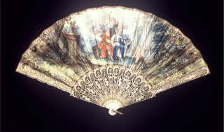 Pleated fan with double leaf. Obverse: parchment leaf painted with classical scene of figures in a garden with architecture and angels. Reverse: silk leaf painted with border design. Carved, pierced and painted ivory sticks backed with mother-of-pearl showing armor and vases. Rivet set with clear faceted stone. Gilt metal bail in shape of bellflower swag.