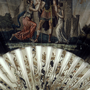 Pleated fan. Printed and hand-colored paper leaf showing a Roman warrior saying farewell to his family before a castle; gilt decoration at edges. Carved and gilded ivory sticks showing chinoiserie scene.