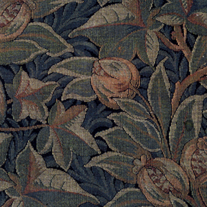 Fragment of upholstery fabric with a design of elaborate vertical, dovetailed and scrolling vines with leaves and fruit in deep green, dark red and ochre superimposed on a blue-green leaf pattern on a black background. Woven imitation of wool needlepoint; square repeat of a rectangular pattern unit reversed in alternate rows.