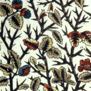 Closely-set pattern of a thorn bush with leaves and berries. Pattern outlined in black, thorn branches in violet, leaves and berries in yellow, red, and blue. Natural cotton ground.