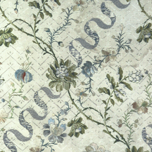 "Fragments of an all-over pattern made up of a bunch of roses with trailing floral vine and a fine detached flowering vine arranged in a group.  The groups are placed side by side and reversed end to end to counter balance movements.  Polychrome pattern on an ""ivory on ivory"" geometric-patterned background."