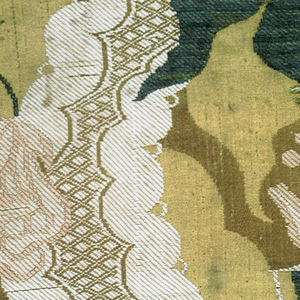 Fragment of yellow silk with 'bizarre' style pattern of green and pink florals, and a curving lace-like ivory band.
