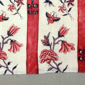 Red stripes with flowers alternate with white stripes with flowers and butterflies.