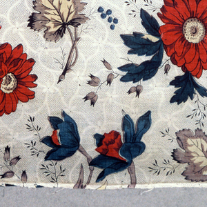 Fragment of printed cotton with half-drop repeat of dahlia-like flowers on a meandering lattice, in many colors on a white ground with black picotage.
