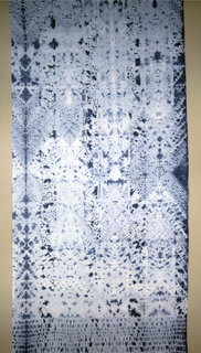 Blue with a pattern of overlapping diamonds and wide border at both ends.