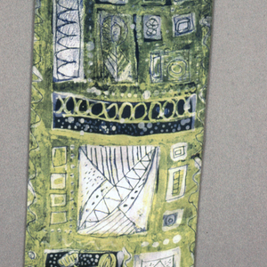 Scenes of squares containing a crowned head, floral form, or miscellaneous geometric forms in green, yellow and white.