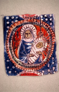Virgin and child in a medallion.