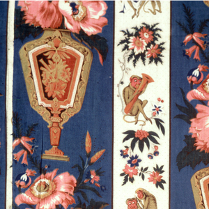 """Unlined bed cover made up of two lengths of printed fabric. Pattern composed of two stripes: the wider with an urn of flowers on a blue background. 18.5cm. wide and the other with a monkey giving another monkey a haircut alternating with a monkey playing a horn seated under a flowering plant. 9.5cm. wide. Two groups of stripes are half dropped and with an additional wide stripe fill full width of fabric. Unit of repeat: 36.5 cm. high x 28 cm. (11"""") wide."""