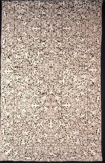 Lace table cover of dense scrolling leaves sheltering birds and animals. Mermaids in each corner and in the field. Vertically and horizontally symmetrical.