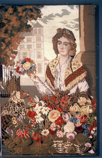 Woman holding a small bouquet of flowers stands behind a basket of flowers. To the left is a small dog. The scene is framed by a pillar on the right and a tree on the left. The facade of a house against the sky in the background.