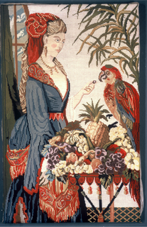 Berlin-work picture of a woman standing before a table laden with fruit feeding a parrot. Strong colors on a white canvas ground.