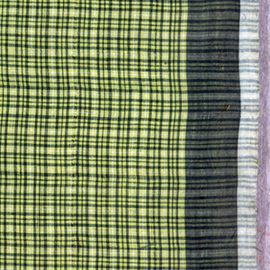 Woven sarong with small scale check pattern in yellow, green, and small amount of white. Solid green forms narrow border on top, bottom, and sides. Two full-width fabrics sewn together.