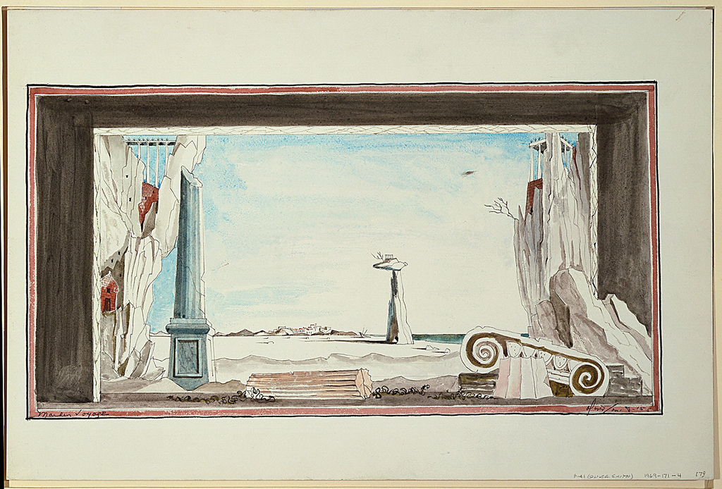 Horizontal rectangle. Set design depicting ancient ruins. The top of an ionic column on far right, broken column at left. Desert and town in far distance.