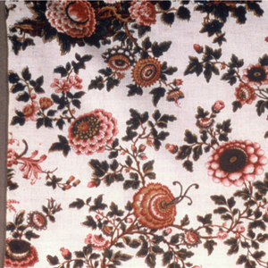 Length of printed cotton with design in off-set repeat of mounds of flowers in bright colors on an undyed ground.