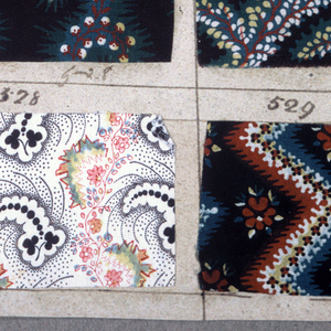 """Forty-six swatches of printed fabric (twenty-three per side of page – one missing on each side) each numbered in pen and ink from 506 through 529. Each swatch measures about 5.5 x 8 cm. (2 1/8"""" x 3 1/8""""). All patterns are small scale floral in at least three colors. Yellow over blue for green."""