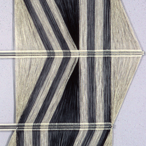 Hanging with a striped warp of natural and black linen. The warps divide to form an open hexagon in the center; the striped bands move in and out to form elongated diamond patterns. The metal rods used to secure the crossings create six horizontal segments.