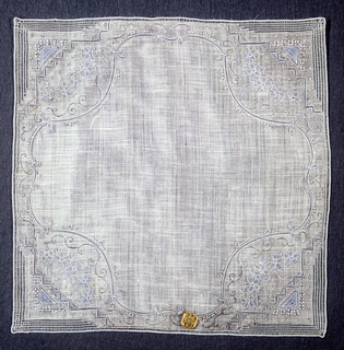 Handkerchief with a pattern of curving scrolls, flowers and bars of openwork embroidery.