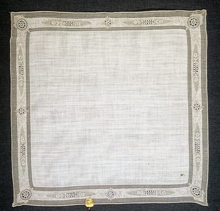 Handkerchief with an embroidered border of flowers and bars.