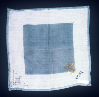 Square handkerchief with a blue square in the middle surrounded by a deep white border and narrow blue outer border. In one corner, the United States Marine Corp logo (eagle, globe, and anchor) is embroidered with U.S.M.C. underneath in dark blue thread. Printed dark blue dashed lines, arrows and squares are in another corner.