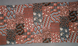 Less than a half-drop repeat of small-scale patterned swatches from a sample book of the 1870s. Predominantly in shades of red and brown.